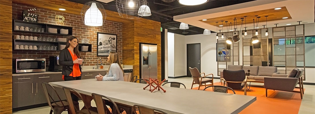 Flexible working Regus office with two people around a large table